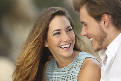 Young couple with cosmetic dental work from Cooley Smiles